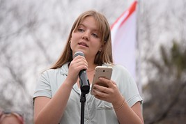 """Avalon Reid spent three hours in a lock-down, at 11 years old, due to a bombing threat at her school. Reid: """"Death permeates the lives of me and my peers. We joke about murder and the end because everyday when we walk into school, we wonder if we will leave in a bus or a body bag. To have fear is what it is to be young today. But fear has inspired us to take to the streets and demand that our lives mean something to our politicians. We demand that we have more rights than a gun. We are here because it seems that the most important lesson that we learn in school is the value of a human life, and it seems to be worth less than $30, which is the cheapest rifle at Walmart."""" - DANYELLE KHMARA"""