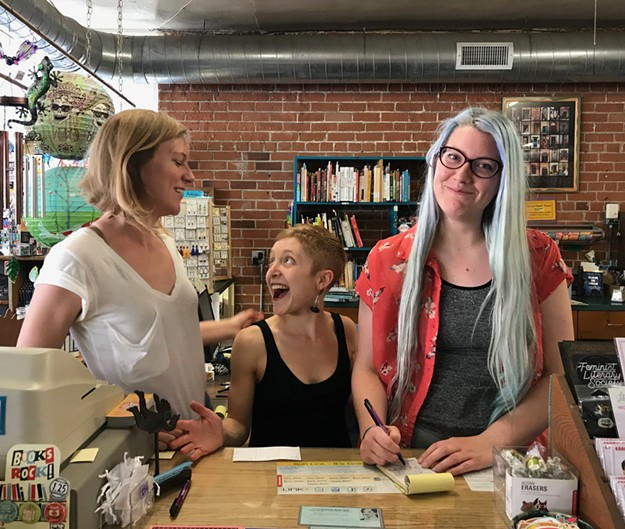 Morgan Miller, left, Kate Stern, middle, and Melissa Negelspach, Antigone Books employees, are raising the money to buy the popular indie book store on Fourth Avenue.