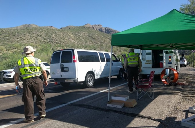 Sheriff's auxiliary volunteers distribute fire safety fliers to motorists heading up Mount Lemmon. - DYLAN REYNOLDS