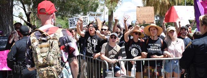 People protest a group holding a Trump rally in Reid Park on Aug. 8. Police put up a barricade to keep the warring factions separate. - PHOTOS BY DANYELLE KHMARA