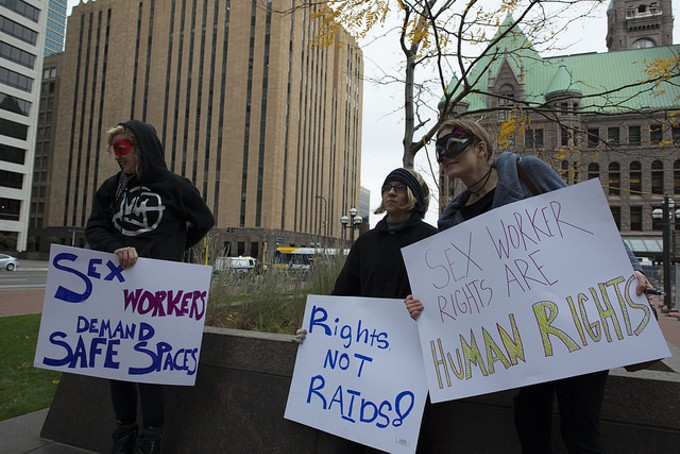 Sex Workers and their supporters gathered in Minneapolis to protest the recent raid and arrests at Backpage, in October 2016. Protesters say sites like Backpage.com allow them to work independently to screen clients and shutting them down exposes them to more risk. - FIBONACCI BLUE