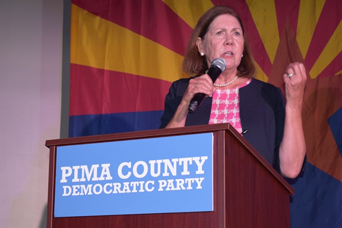 Ann Kirkpatrick takes the stage at the Pima County Democrats election event, with a comfortable lead over her opponents in the CD 2 Democratic primary - SAVANAH MODESITT
