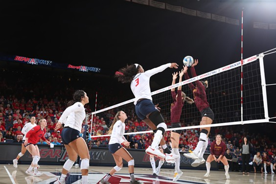 Shardonee Hayes slams home a spike against Arizona State on Thursday, Sept. 20. Hayes had 9 kills and 3 blocks for the Wildcats in a straight sets win over the Sun Devils. - STAN LIU | ARIZONA ATHLETICS