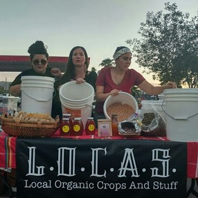 Women in the Food Justice Organization, L.O.C.A.S, hand out food samples. - L.O.C.A.S - LOCAL ORGANIC CROPS AND STUFF