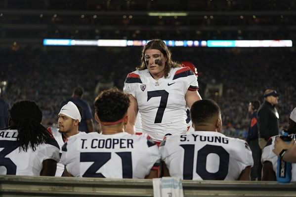 Arizona linebacker Colin Schooler chats with teammates Tristan Cooper and Scottie Young Jr. during the Wildcats' 31-30 loss to UCLA on Saturday, Oct. 20. - CONNOR BUSS, FOREWORD FILMS