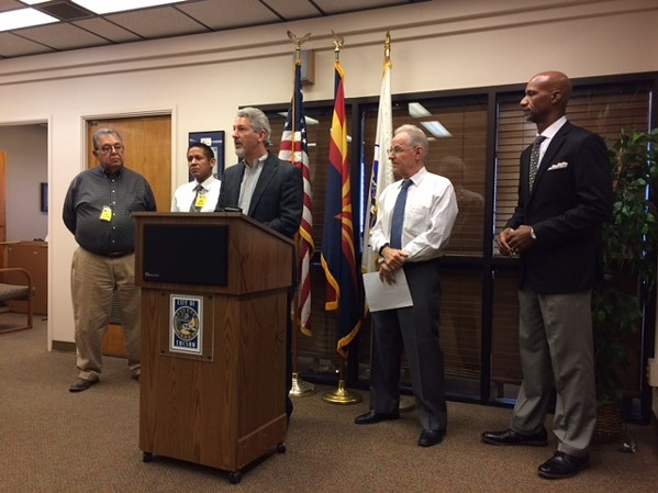 Neal Eckel, secretary/ treasurer of the Tucson Industrial Development Authority Board of Directors, speaks at a news conference at the office of Mayor Jonathan Rothschild on Friday, Sept. 28. - PATHWAY TO PURCHASE