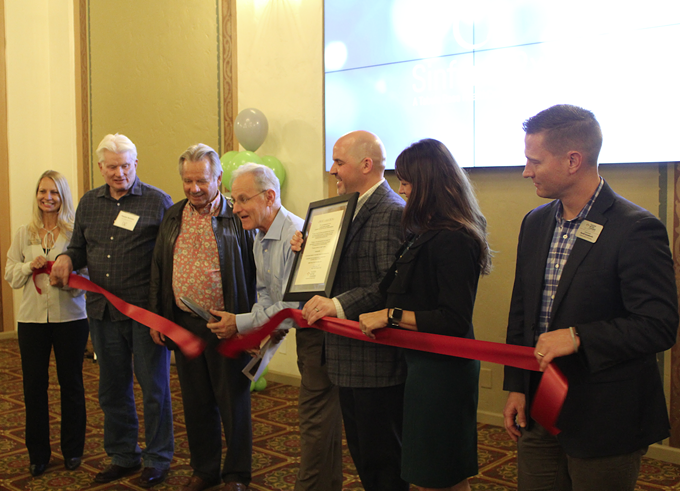 Mayor Jonathan Rothschild cuts a ribbon for the Pioneer Hotel dining room