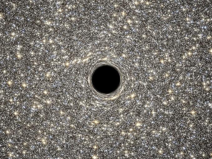 Artist's impression of a black hole. - COURTESY NASA, ESA, D. COE, G. BACON