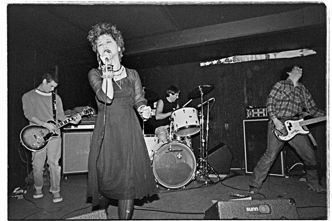 """Tucson's own Conflict (US) playing at Nino's on 1st Ave., Feb. 27th, 1984. Conflict (US) was one of the very few female fronted hardcore punk bands. Karen Allman (Karen Nurse) formed the band in 1981 with drummer Nick Johnoff. Nick worked so hard to build the punk scene almost single-handedly and booked almost all the touring hardcore shows back then. Ironically, I think this was Conflict's very last show."" - ED ARNAUD"