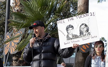 Dan Millis, a No More Deaths volunteer who was convicted of littering in 2008, shares his experiences with protesters outside the Deconcini Federal Courthouse on Tuesday. - PHOTO BY MEG POTTER/CRONKITE NEWS