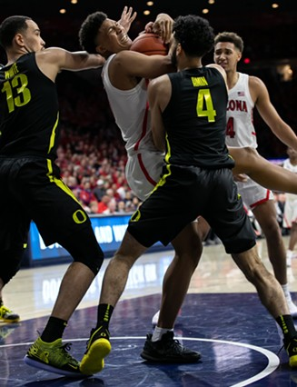 Arizona forward Ira Lee, Center, fights for a rebound during the Arizona-Oregon game on January 17 in Tucson, Ariz. Lee finished the game with nine points. - SIMON ASHER FOR TUCSON WEEKLY