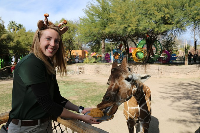 Denver the giraffe and Reid Park Zoo Keeper Kelly celebrating the former's 30th birthday. The first 20 people who go to the zoo Friday, Feb. 1 at 10 a.m. can feed Denver a birthday treat. - COURTESY REID PARK ZOO