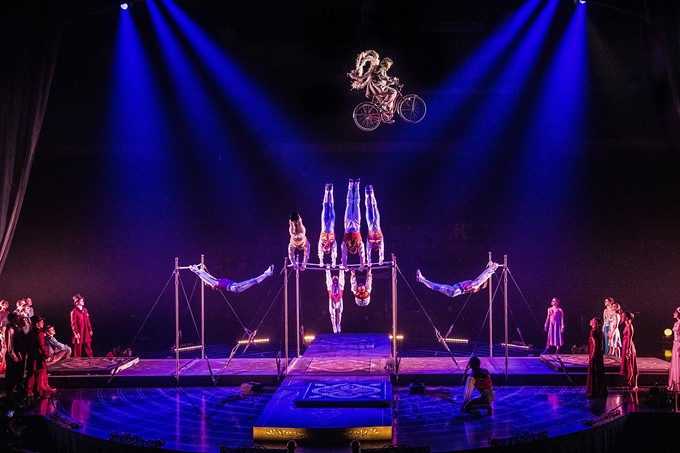 Tournik: A group of artists cross paths in an act which - marries horizontal bar techniques with circus - arts. - COURTESY CIRQUE DU SOLEIL
