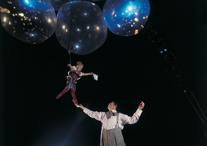 Helium Dance: A tender and poetic moment between Mauro the Dreamer Clown and his little Clowness who bespells the audience with child-like delight. - COURTESY CIRQUE DU SOLEIL
