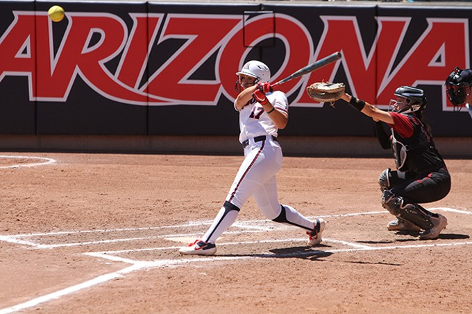 Arizona junior infielder Malia Martinez drives a pitch to left field during the Wildcats' 13-2 win over Stanford University on Saturday, April 20. - CHRISTOPHER BOAN