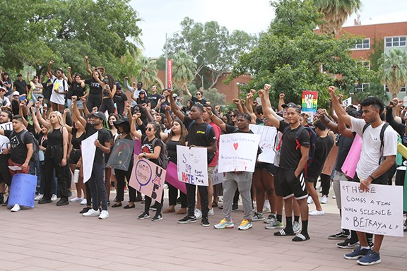Students and community members gathered outside the University of Arizona's administration building on Sept. 13 to protest of the handling of an attack on a black student. - JAMIE VERWYS