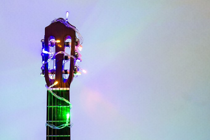 bigstock-acoustic-guitar-wrapped-by-col-332818528.jpg