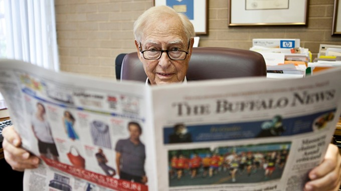 Buffett scans the classifieds after selling media empire to Lee Enterprises for $140 million. - PHOTO BY BRENDEN BANNON FOR THE NEW YORK TIMES