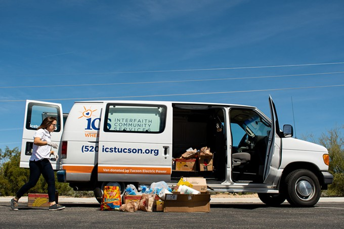Interfaith Community Services Faith and Community Outreach Manager Lauryn Valladarez loads donated food and cleaning supplies into an ICS van parked at St. Mark the Evangelist Catholic Church in Oro Valley (2727 W. Tangerine Road). ICS is taking donations until 2:30 p.m. - PHOTOS BY LOGAN BURTCH-BUUS