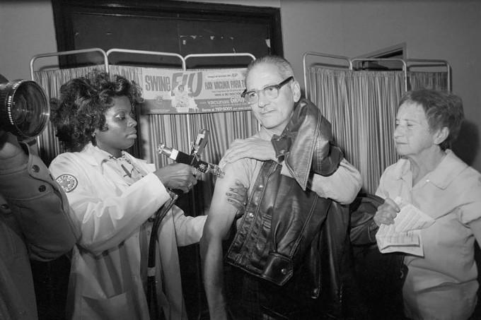 Nurse Jacqueline Spaky administers a swine flu injection in New York City as part of a mass immunization program that followed a swine flu outbreak in Fort Dix, New Jersey, in 1976. (Bettmann/Getty) - PROPUBLICA