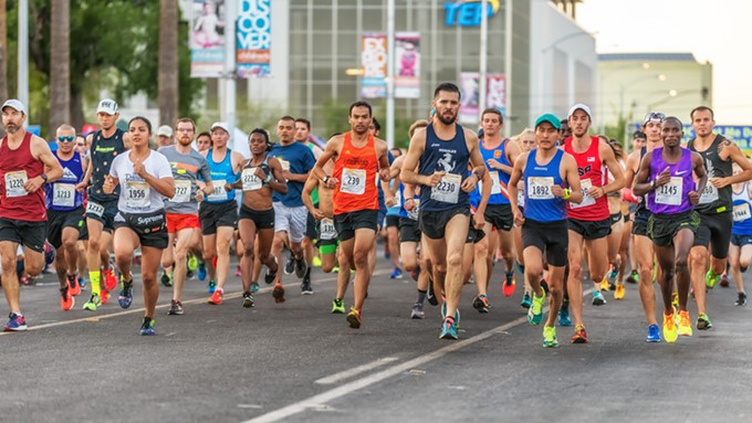 A group of runners start the TMC MeetMeDowntown 5K in 2018. The race, part of the Gabe Zimmerman Triple Crown organized by Run Tucson, will be run virtually this year. - COURTESY GOATOGRAPHER/KERRY WHELAN