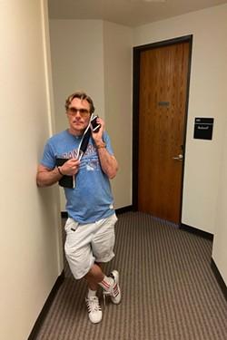 Zelonka calls Jason Cardiff, a representative for VPL, outside an office unit registered to the company. (J. David McSwane/ProPublica)