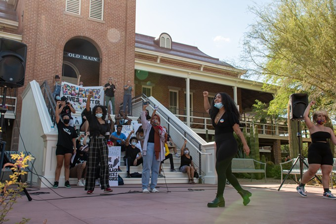 "March For Justice Tucson organizers lead over 1,000 attendees of Wednesday's demonstration in chants of ""Say his name"" and ""George Floyd"" before the June 3 demonstration on the University of Arizona Mall. - LOGAN BURTCH-BUUS"