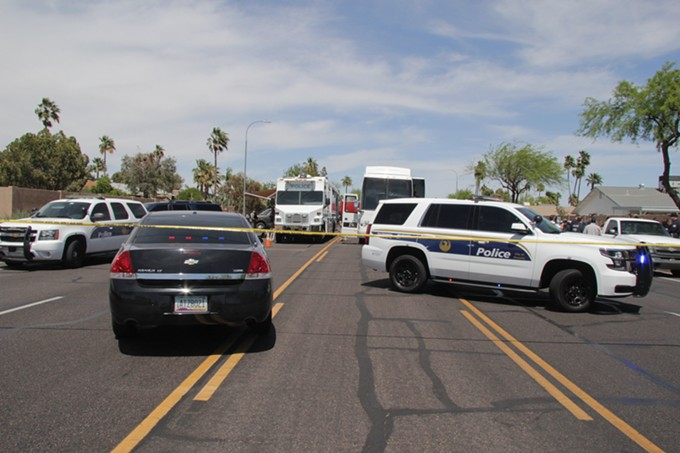Phoenix police cordon off the scene shortly after the shooting involving agents of Homeland Security Investigations (HSI). Marked police cruisers, unmarked law enforcement and first responder vehicles block the neighborhood thoroughfare. (Crime scene photo: Phoenix Police Department)