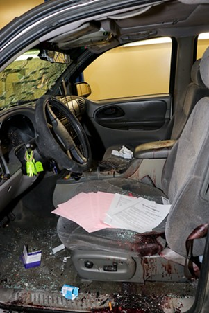 A crime-scene photo shows the blood-soaked driver's seat of Warren Jose's bullet-riddled Chevrolet Trailblazer, which was driven by Theresa Medina Thomas, who was shot to death by agents with Homeland Security Investigations on the morning of April 11, 2019. (Crime scene photo: Phoenix Police Department)