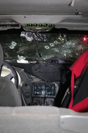 A crime-scene photo shows the bullet-riddled windshield of suspect Warren Jose's Chevrolet Trailblazer. Police investigators said that Jose fired an assault rifle through the windshield from the front passenger's seat. (Crime scene photo: Phoenix Police Department)