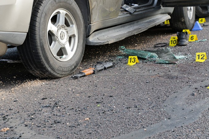 A crime-scene photo shows a sawed-off AK-47-style rifle lying near Warren Jose's Chevrolet Trailblazer, which fell to the ground when agents pulled Jose from the SUV after the shooting stopped. (Crime scene photo: Phoenix Police Department)