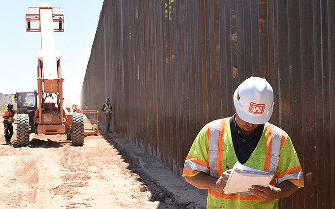 A U.S. Army Corps of Engineers contractor takes notes in May during work on the border wall near Yuma. Much of the funding for border wall construction this year was shifted from the Pentagon and other agencies' budgets, which has been challenged by the House of Representatives. - PHOTO BY ROBERT DEDEAUX/U.S. ARMY CORPS OF ENGINEERS