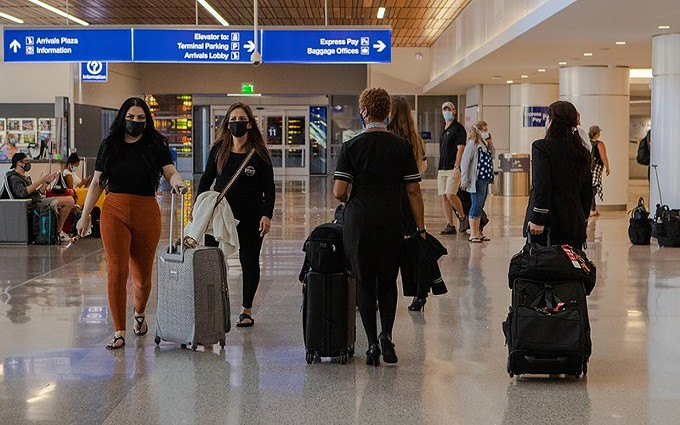 A number of U.S. airlines furloughed thousands of workers Thursday, one day after a federal aid package to help carriers through the coronavirus pandemic expired. Those included hundreds of furloughs at Phoenix Sky Harbor International Airport. - PHOTO BY ALLIE BARTON/CRONKITE NEWS