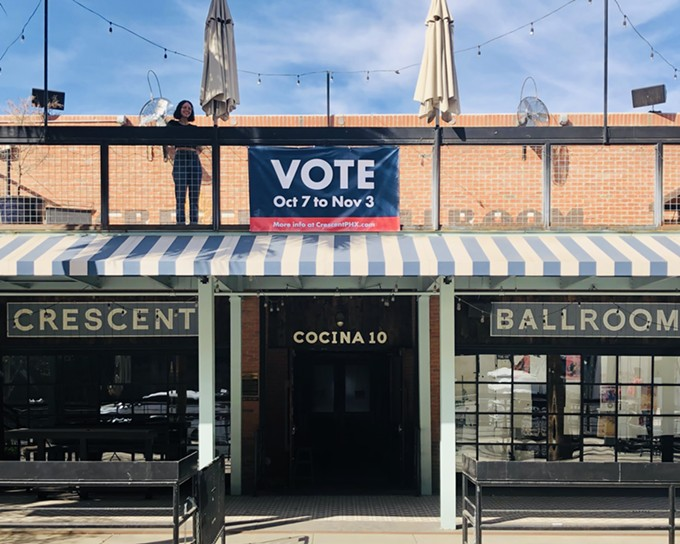 """Crescent Ballroom General Manager Angela Donato stands by a """"vote"""" banner at the downtown Phoenix music venue. - MARIA LEKMAN"""