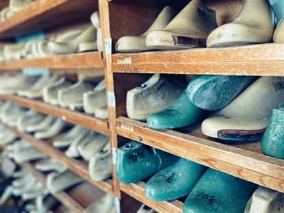 Wall of moccasin molds in a back Desert Son workshop. - BRIAN SMITH