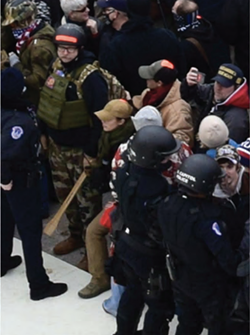 Felicia and Cory Konold at the front of a crowd who stormed the U.S. Capitol. - UNITED STATES DISTRICT COURT CRIMINAL COMPLAINT FILED FEB. 10