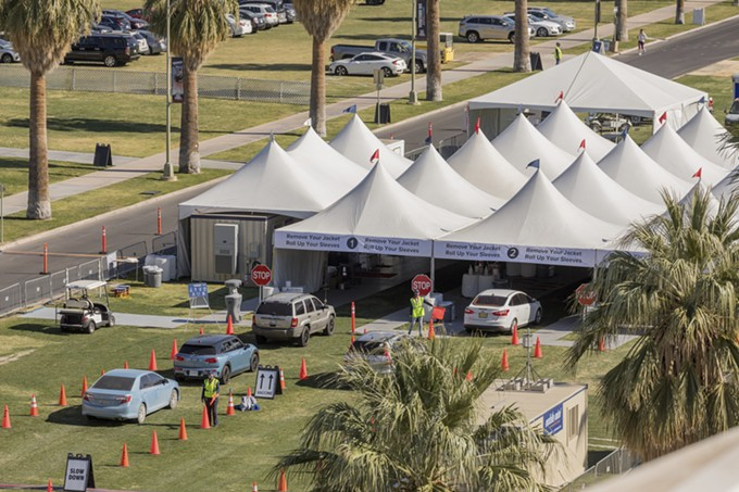 Cars filter through the COVID-19 vaccine point of distribution at the University of Arizona's Campus Mall. On Feb. 18, UA will begin operations as a state-run vaccine site. - CHRIS RICHARDS/UNIVERSITY OF ARIZONA