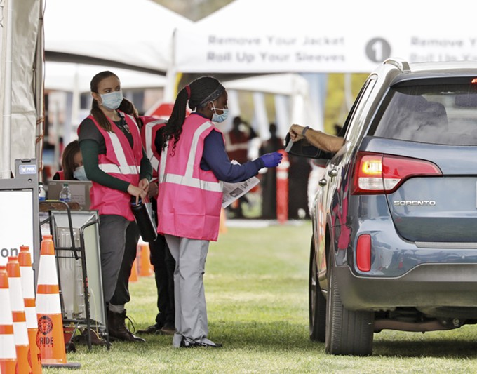 Volunteers assist drivers at COVID-19 vaccine point of distribution at the University of Arizona's Campus Mall. - THE UNIVERSITY OF ARIZONA