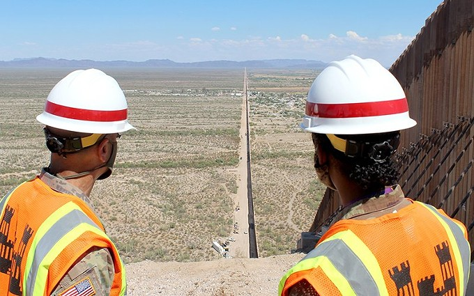 Two Army Corps of Engineers officers look down the U.S.-Mexico border near Lukeville. President Donald Trump said Thursday, suring a visit to the wall in Yuma that the 300th mile of wall would be completed soon. - GEORGE F. JOSENS/U.S. ARMY