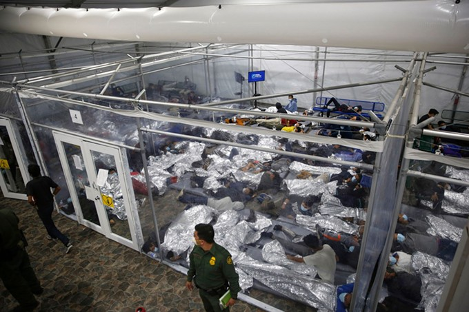 Unaccompanied minors lie inside a pod at a Department of Homeland Security holding facility in Donna, Texas, the main detention center for unaccompanied children in the Rio Grande Valley. The minors are housed by the hundreds in eight pods of about 3,200 square feet, many of which hold more than 500 children. The Biden administration allowed journalists inside the detention facility for the first time on Tuesday, revealing a severely overcrowded tent structure filled with more than 4,000 kids and families, where the youngest children were kept in a large playpen with mats on the floor for sleeping. - DARIO LOPEZ-MILLS/POOL/AP