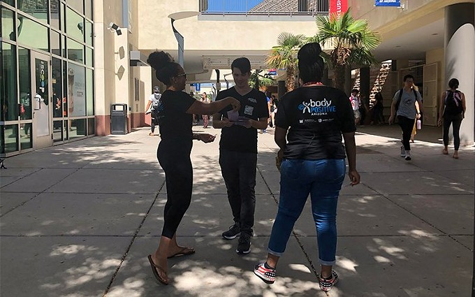 Before the pandemic, Body Positive Arizona took to the University of Arizona mall to hand out compliment cards. It's a project the group hopes to soon resume. - LISA MACDONALD