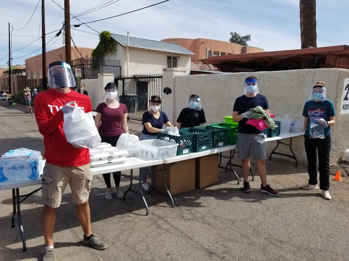 Volunteers lined up to hand out food, water, blankets, hygiene supplies, and pet food. - DAVINA DOBBINS