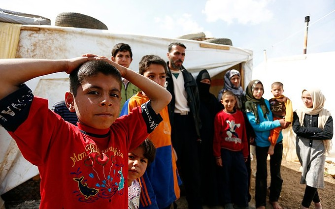 A family in a Lebanese refugee camp in a 2013 file photo. After years of cuts under the Trump administration, President Joe Biden said this month that he wants to raise the cap on refugee admissions, but few – including Biden – expect to come near the limit this year. - DRAGAN TATIC, AUSTRIAN MINISTRY OF FOREIGN AFFAIRS/CREATIVE COMMONS VIA CRONKITE NEWS