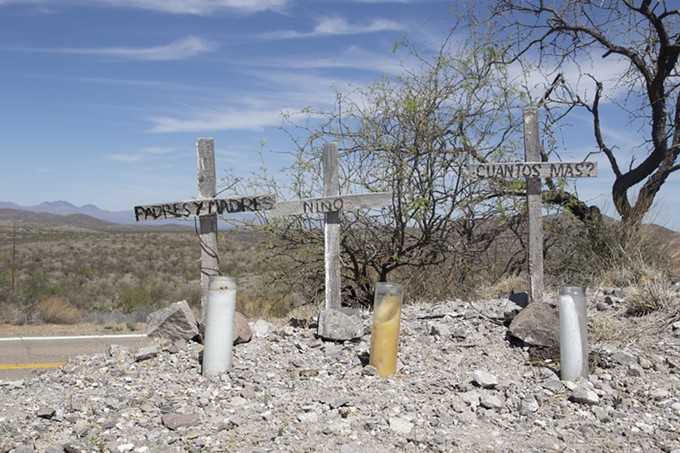 Three wooden crosses mark the location where the remains of a family were found near Arivaca in April. They were among a record-setting 127 migrant remains recovered in the Arizona desert in the first six months of this year. - GRACE OLDHAM/CRONKITE BORDERLANDS PROJECT