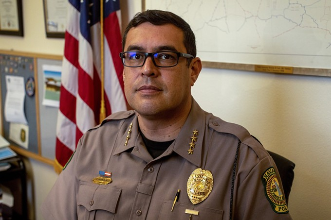 Navajo Chief of Police Phillip Francisco sits in his office in Window Rock. Since taking the position in 2016, he has been a vocal advocate for upgrades in the department, which has 200 employees. - BETH WALLIS/NEWS21