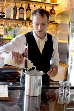 Bartender Jacob Hise turns tequila into caviar-like droplets. - HEATHER HOCH