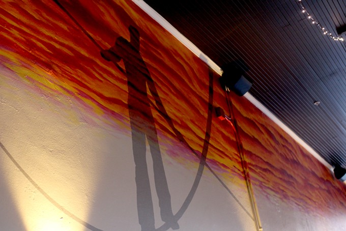 A Joe Pagac mural inside depicts Johnny Gibson as a tightrope walker. - HEATHER HOCH