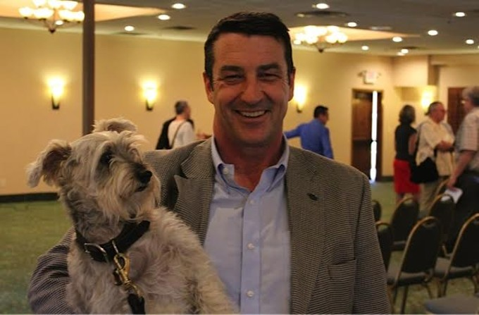 "Pima County Supervisor Ray Carroll said he and his dog Simon are supporting the bond package: ""Simon told the people that if they supported the animal-care package, that he'd come back and support their seven questions. He's standing by his word."" - JIM NINTZEL"