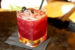 Mezcal, Cynar and blueberry and beet syrup make the Tyson Buhler's Day Off well balanced. - HEATHER HOCH