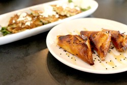 Phyllo and potato fritters are available to start or during happy hour. - HEATHER HOCH